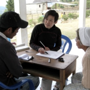 Sr Filomena, Blanche and Tino discussing dental theory on the verandah of the church offices in Letefoho